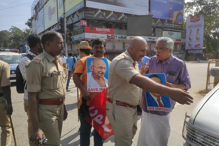 Mangaluru police detain Kerala CPI MP Binoy Viswam for protesting during curfew
