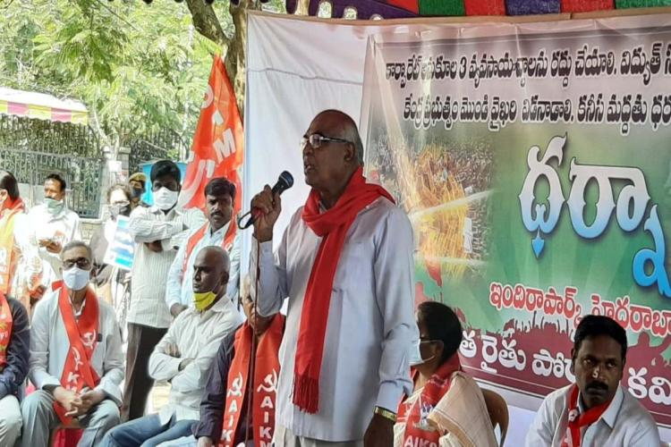 CPI general secretary Chada Venkat Reddy addressing the gathering with a mic in his hand