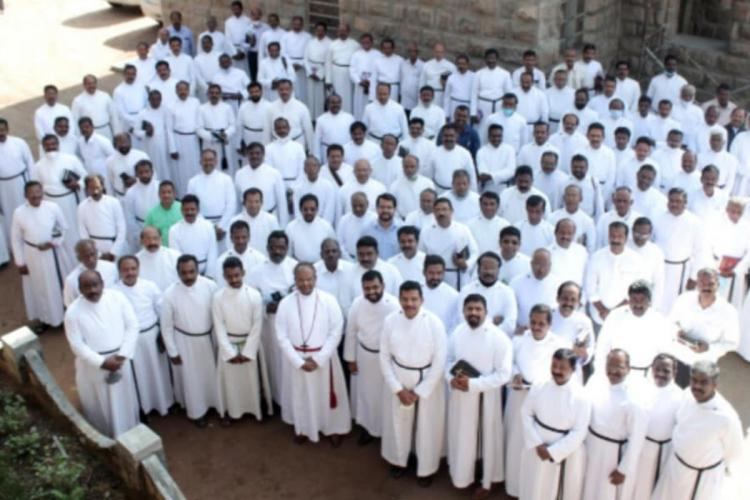 A congregation of CSI priests in Kerala dressed in white