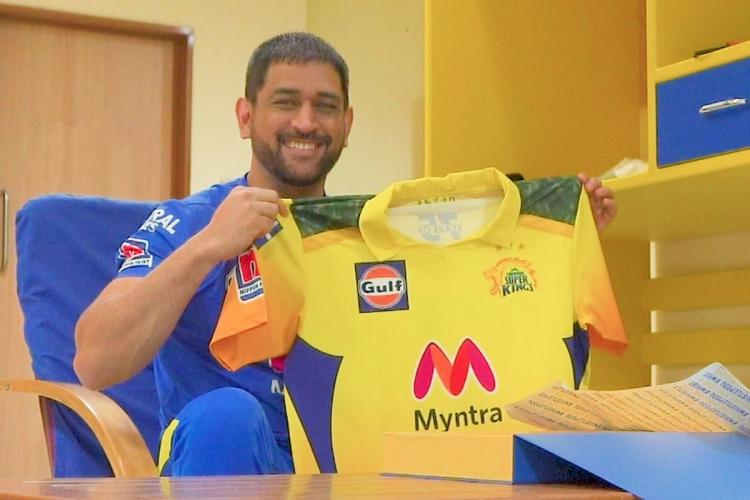 Dhoni holding up CSK new jersey