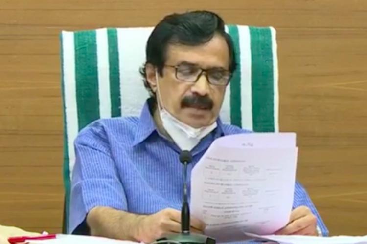 Kerala Education Minister C Raveendranath wearing a blue shirt