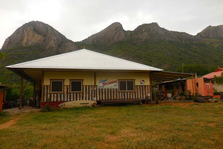 The main building of Camp Splendour with hills in the background
