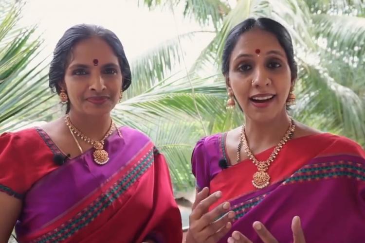 Carnatic vocalist duo Ranjani and Gayatri dressed in purple and red silk sarees