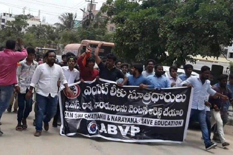 EAMCET leak Demanding ban on Sri Chaitanya and Narayana ABVP stages protest in Hyd