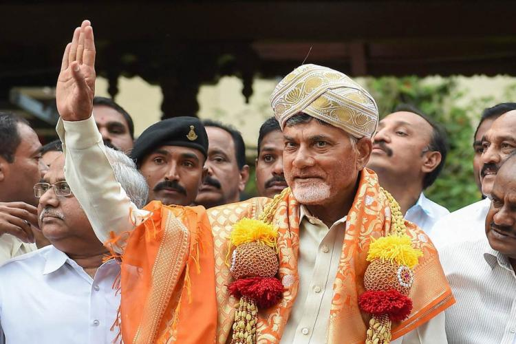 TDP president N Chandrababu wearing a turban and waving at the crowd