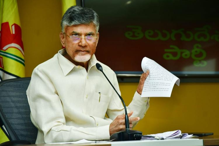 Chandrababu Naidu addressing a gathering and holding up a document in one hand