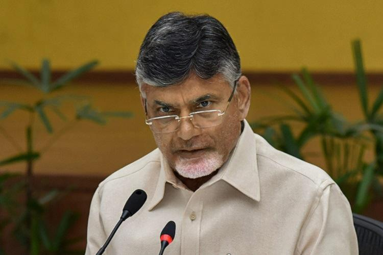 Chandrababu nair wearing speaks and speaking over a mic