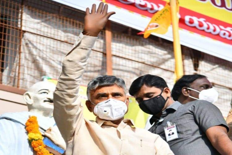 Andhra Opposition leader Chandrababu Naidu waving his hand