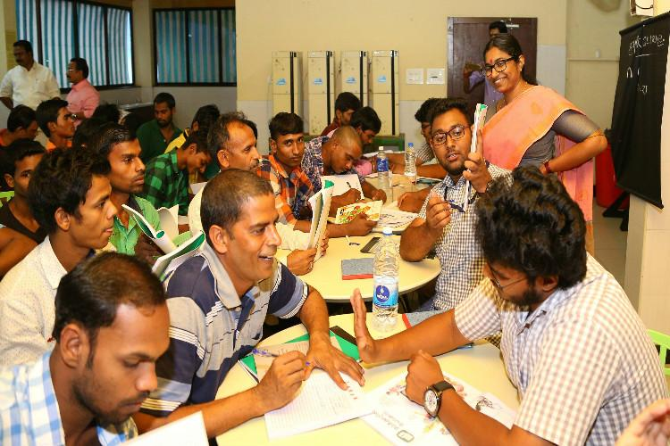 Keralas second literacy revolution Govt teaches Malayalam to migrant workers
