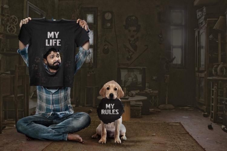 Rakshit Shetty is seen with a Labrador