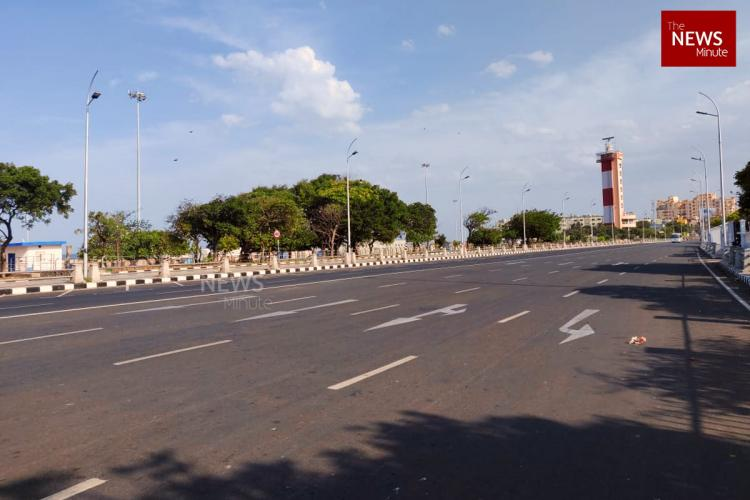 On day 1 of the Chennai lockdown empty Kamarajar Salai with the Lighthouse in the distance