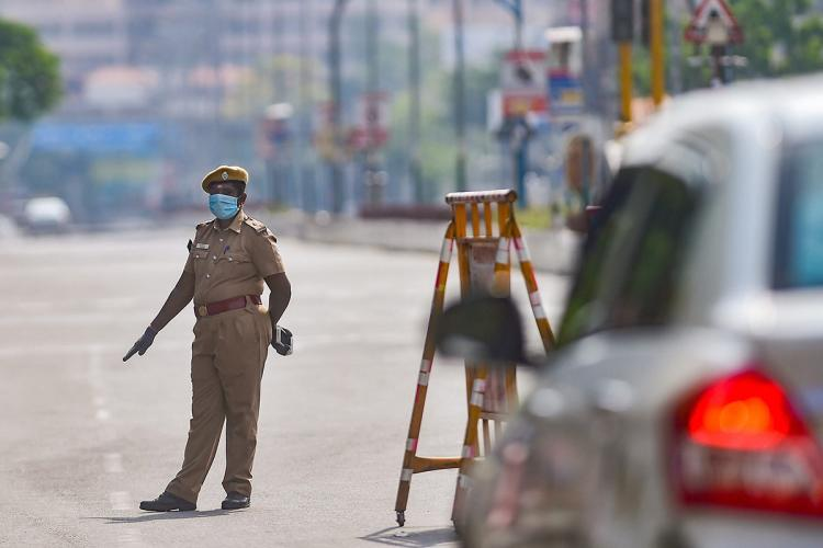 Police officials checking vehicle movement during complete lockdown in Chennai