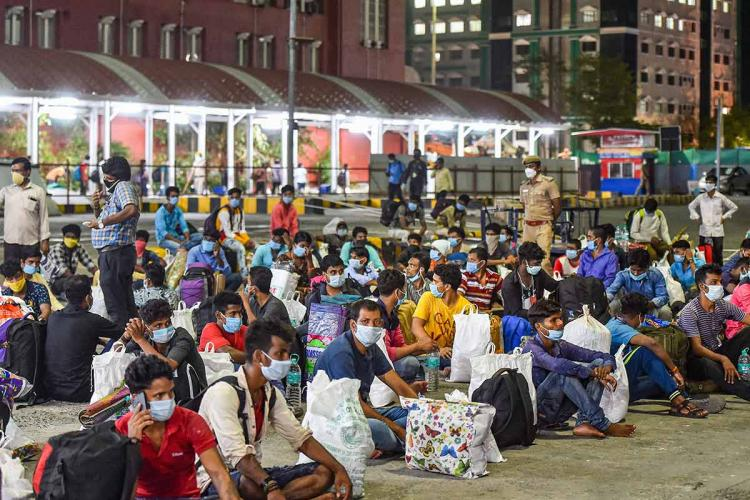 Migrant workers seated outside Chennai central railway station