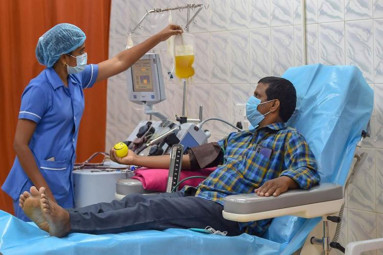 A donor in a hospital who is donating plasma for treatment of COVID patients