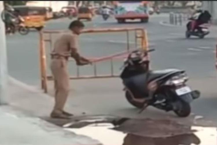 Caught on camera Chennai cop smashes two-wheeler parked on road