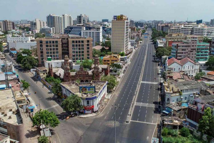 Vehicles ply on the deserted Mount road during an intensified lockdown as a preventive measure against the spread of coronavirus disease in Chennai Friday June 19 2020