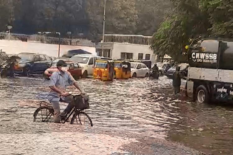 Motorist in water logged Chennai road