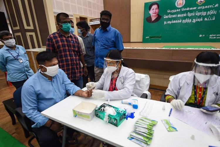 Doctor testing a patient in Chennai for COVID-19