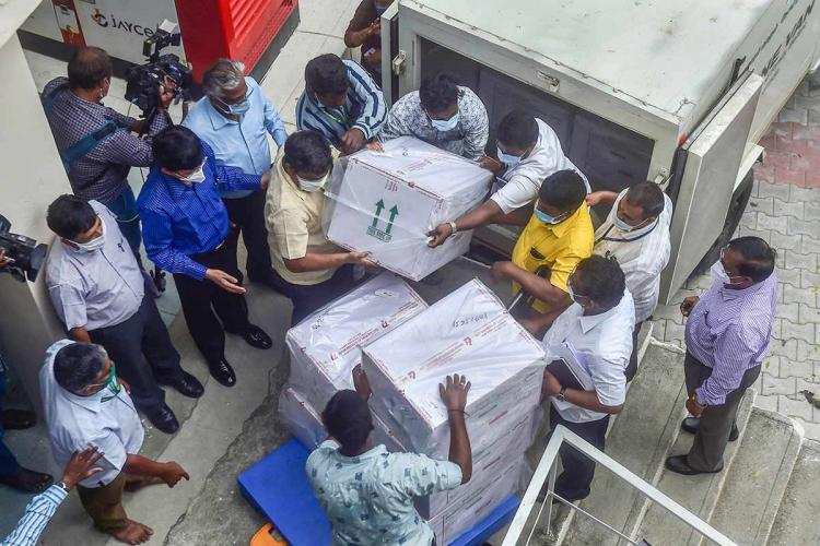 First consignment of Covishield being unloaded from a truck in Chennai Health Secretary J Radhakrishnan is seen supervising the operation while others look on