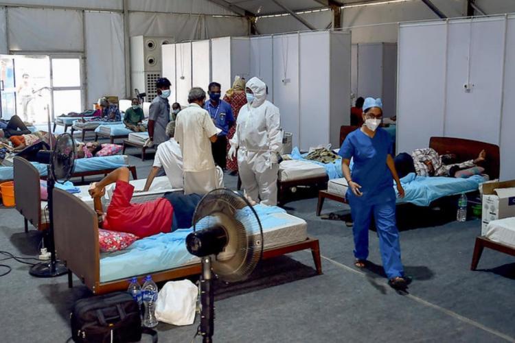 COVID-19 patients undergo treatment at a COVID-19 treatment centre in Chennai