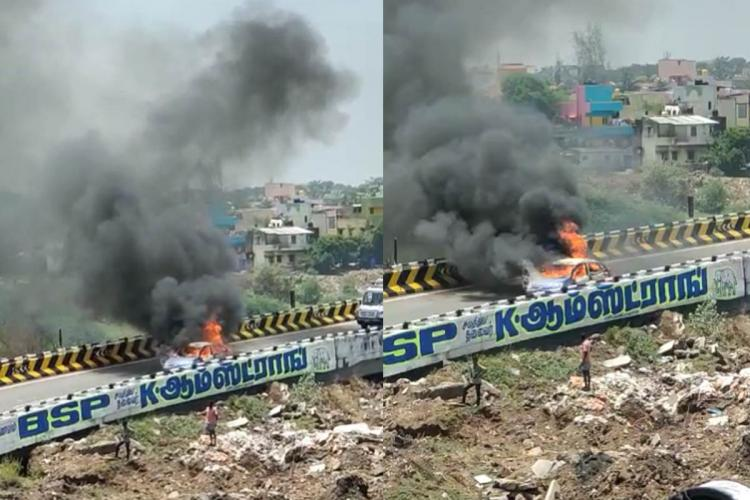 Dramatic visuals showed grey and black smoke billowing from the car parked on the Koyambedu flyover