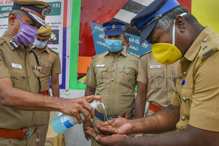 Police officers being given sanitisers