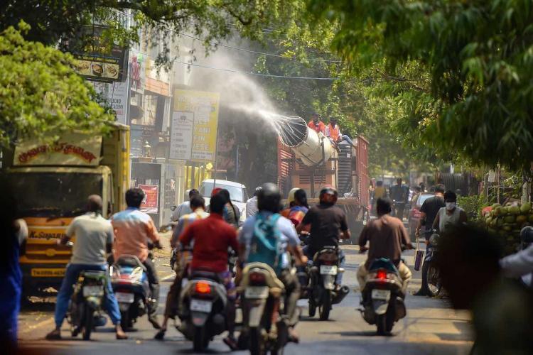 Sanitising in Chennai road