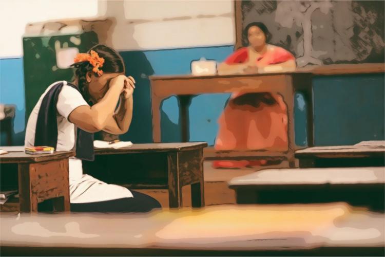 School girl crying in classroom as teacher looks on
