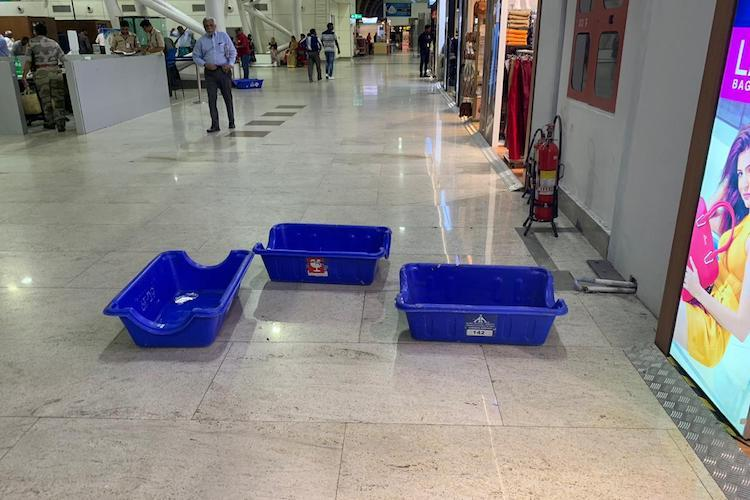 Roof turned into showers DMKs Kanimozhi slams Chennai airport for leaky roof