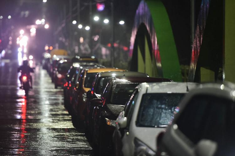 Residents park their vehicles on a flyover before the landfall of Cyclone Nivar at Velachery in Chennai