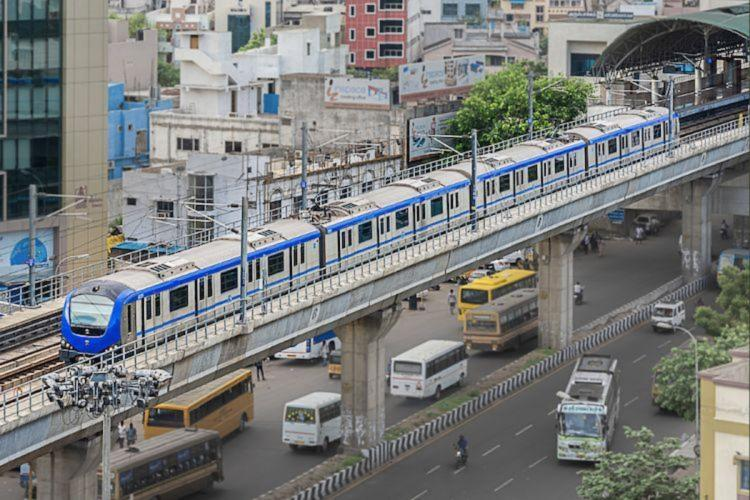 An aerial photo of a Chennai metro rail coach traveling between stations