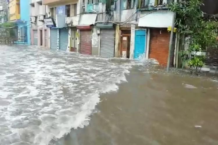 Rain water flooding Wall Tax Road