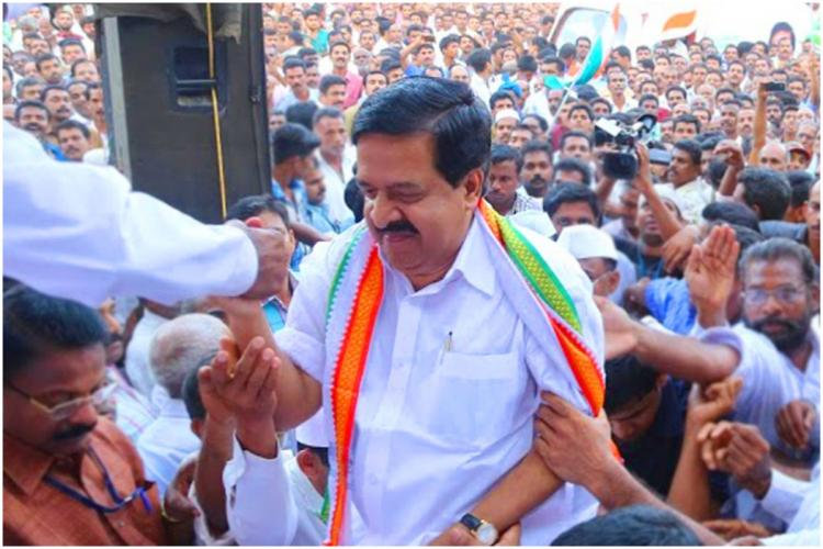Kerala Opposition Leader Ramesh Chennithala among a crowd who gathered during an Assembly election campaign