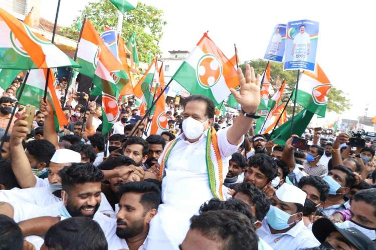 Congress leader of Kerala Ramesh Chennithala being raised by party workers during the Aiswarya Kerala Yatra