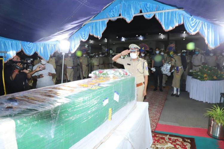 Cyberabad Commissioner of Police VC Sajjanar paying tribute in front of the mortal remains of jawan Shakamuri Murali Krishna