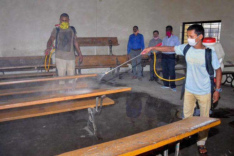 an exam hall in Chikmagalur being sprayed with disinfectants ahead of the SSLC examinations