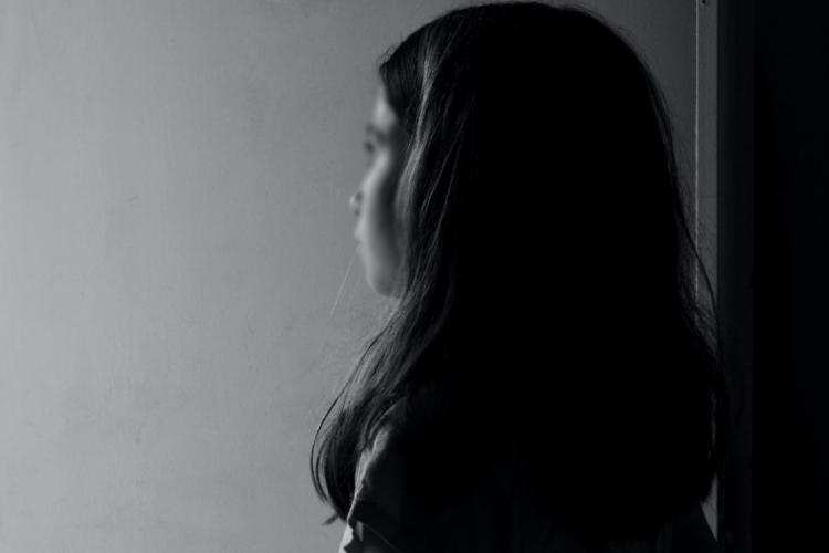 Girl standing alone