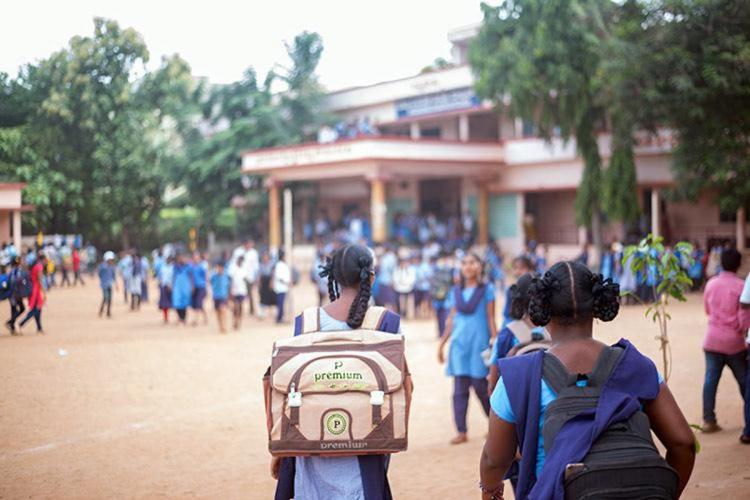 A school campus and children entering the school