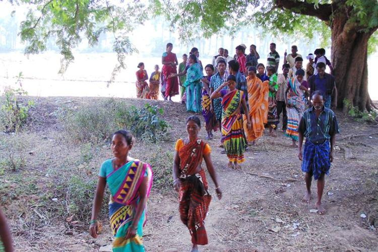 Police stole our paddy allege Andhra tribal farmers after crops seized in land dispute