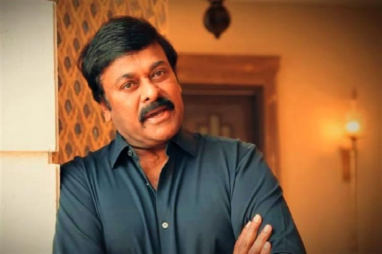 File photo of Chiranjeevi wearing a blue shirt and looking into the camera with folded arms
