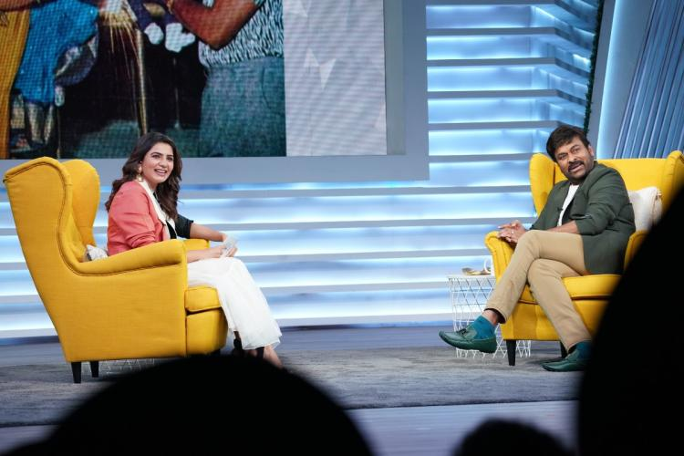 Samantha and Chiranjeevi seated in yellow chairs for a talk show