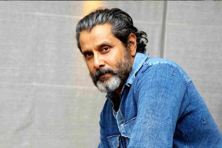 Actor Chiyaan Vikram wearing blue shirt