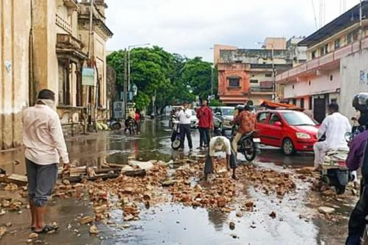 Debris from the Chowmahalla Palace in Hyderabad on the road