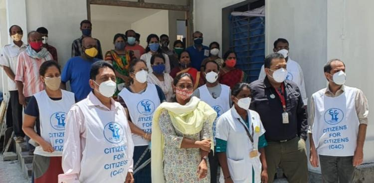 Volunteers of Citizens for Citizens Dr Vaishnavi and the beneficiaries posed for a photo outside the PHC