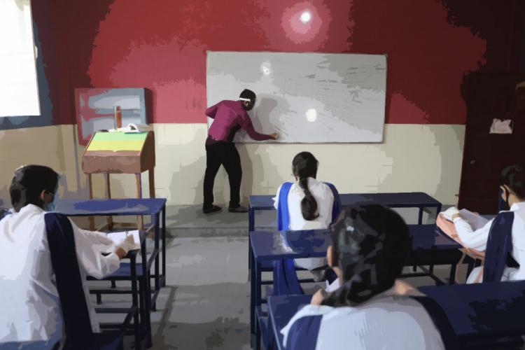 Classroom with male teacher and female students