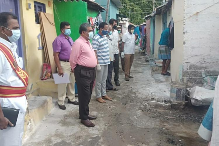 Coimbatore Collector Rajamani along with officials inspecting the containment zones