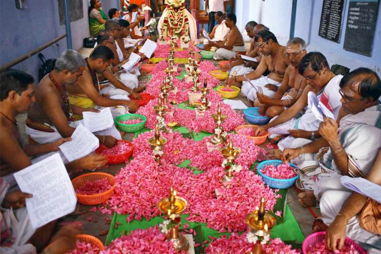 Representative image of priests in a temple reciting mantras