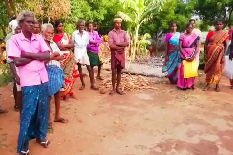 Group of people gathered together at a tribal settlement in Coimbatore