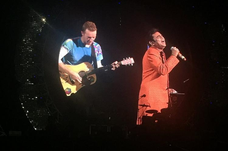 Watch Coldplay Dazzles Mumbai Modi Quotes Bob Dylan At Global