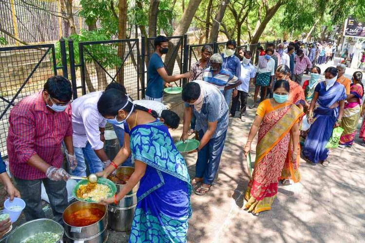 Social volunteers distribute free-food to homeless and the poor during the lockdown to contain the spread of Covid-19 in Hyderabad Monday March 30 2020